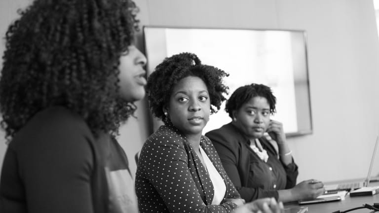 Black Women Aren't Being Paid for Eight Months of Their Work