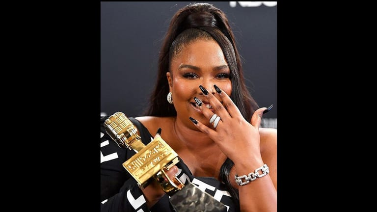 Get the Look: Lizzo's High Ponytail and 'Vote' Nails for the Billboard Awards