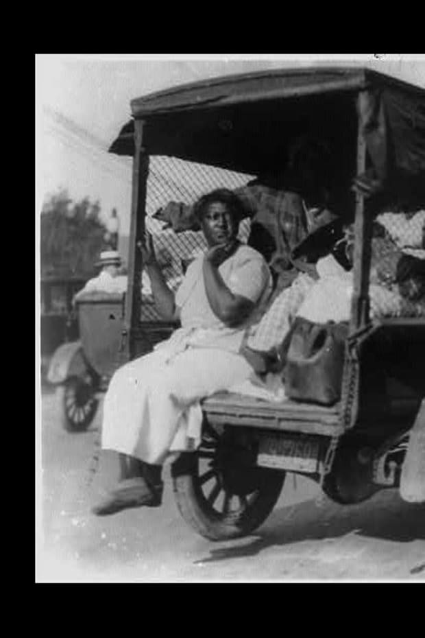 Rear view of truck carrying African Americans during the Tulsa, Oklahoma, massacre of 1921 / by Alvin C. Krupnick Co., Tulsa, Okla.