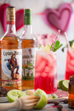 Ingredients:¾ oz Captain Morgan Original Spiced Rum¾ oz Captain Morgan Sliced Apple1 oz Cranberry Juice¼ oz lime juice1.5 oz ginger beerGarnish: lime wedge and cranberriesDirections: Combine all ingredients into a shaker tin except for the ginger beer. Shake and strain into an ice-filled highball glass. Top with ginger beer and garnish with cranberries and lime wedge.