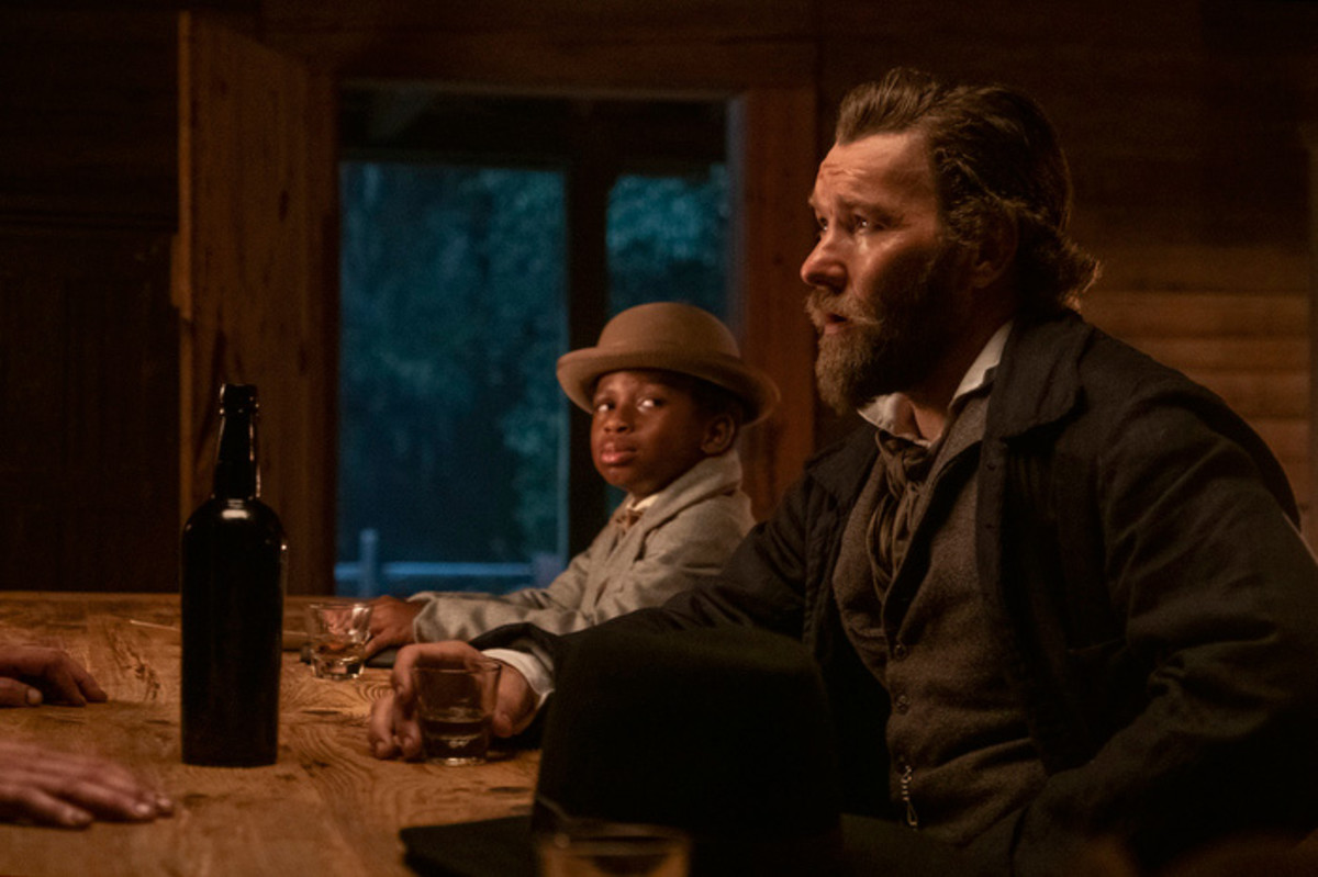 Chase W. Dillon as Homer and Joel Edgerton as Ridgeway in The Underground Railroad