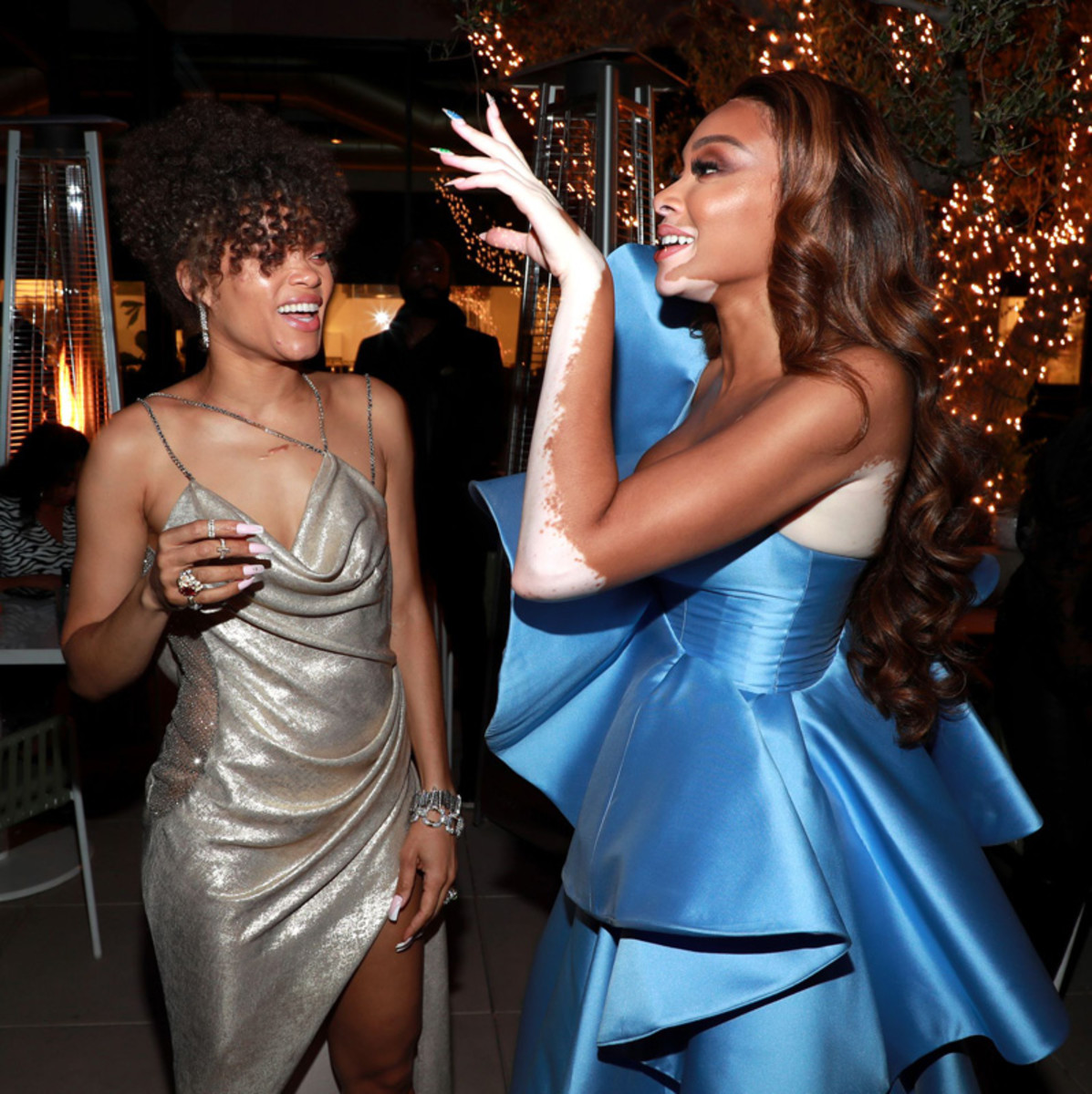 Andra Day and friend Winnie Harlow share a moment at an Oscars party thrown in Day's honor.