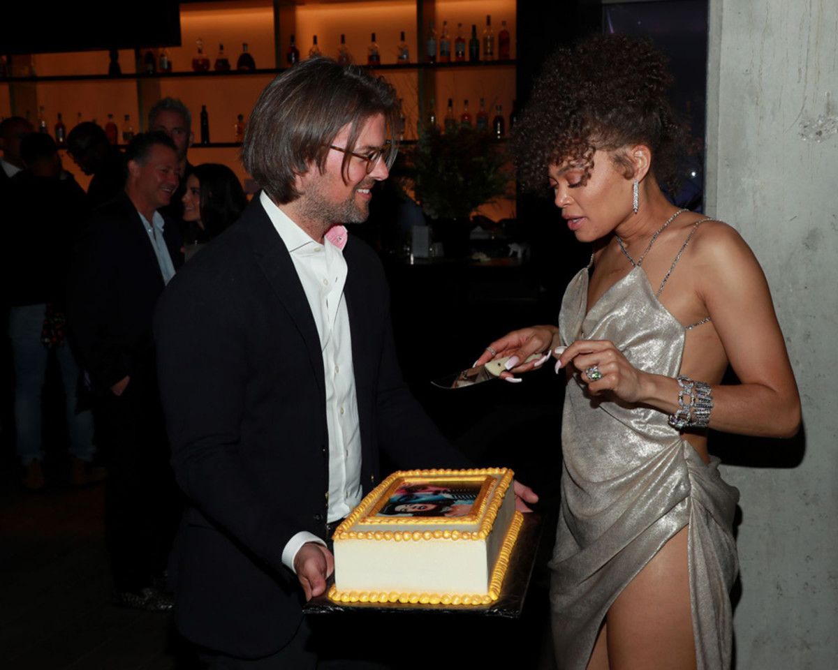Magnus Resch presents Andra Day with a cake at the Oscars after-party given in her honor.