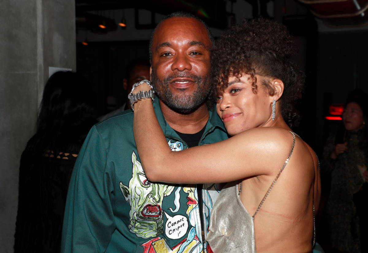 Lee Daniels and Andra Day embrace at an Oscars after-party thrown in her honor.