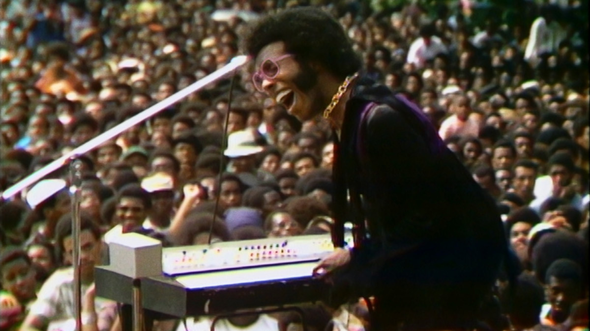 Sly and the Family Stone entertain thousands of people during the Harlem Cultural Festival.