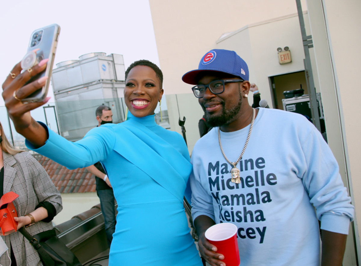 Yvonne Orji and Lil Rel Howery take a selfie at the Vacation Friends Special VIP Pool Party Screening at The Hollywood Roosevelt on August 23, 2021 in Los Angeles.