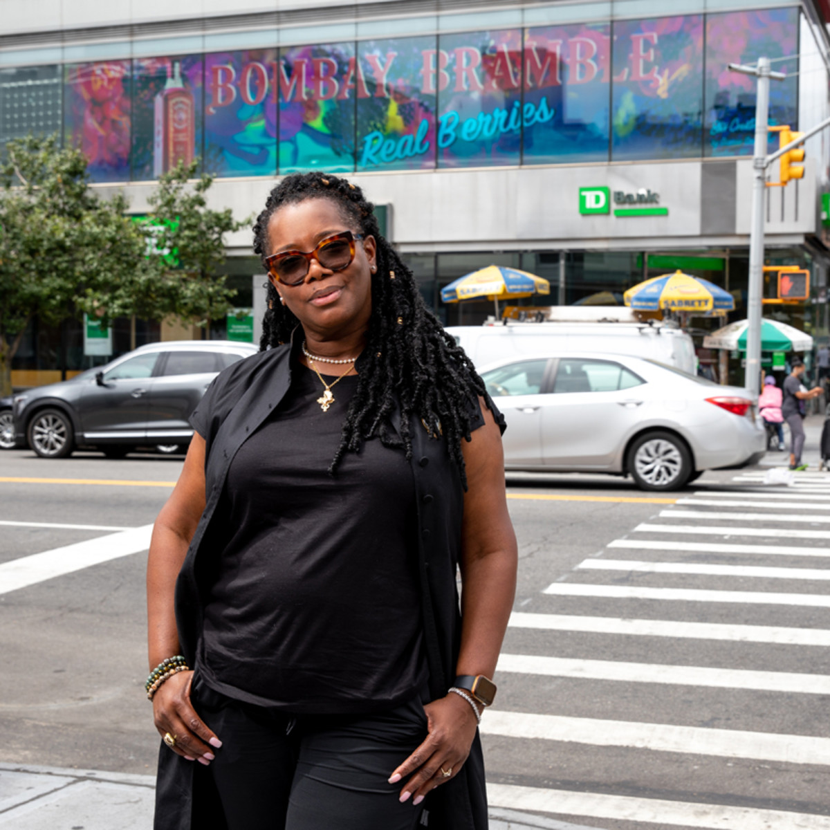 Dianne Smith stands in front of her Bombay Bramble billboard